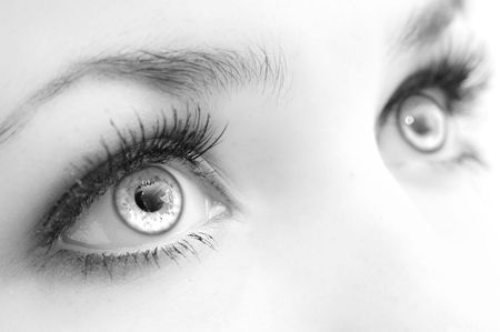 eye lashes: Beautiful female  eyes, very close, black-and-white. Expressive sight