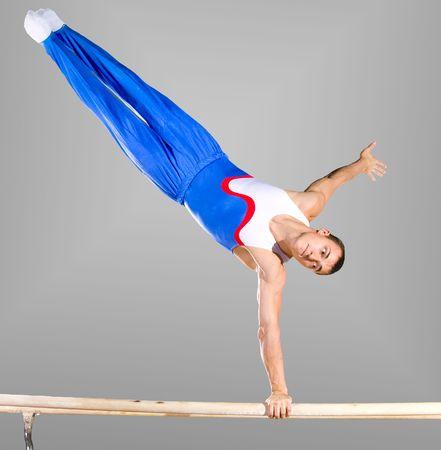 gymnastik: Die Sportler Guy, f�hrt schwierigen �bung, Sport-Turnen Lizenzfreie Bilder