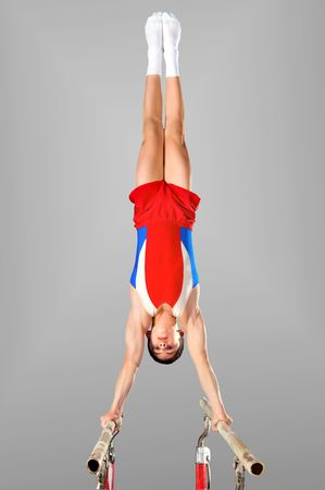 The sportsman the guy, carries out difficult exercise, sports gymnastics photo