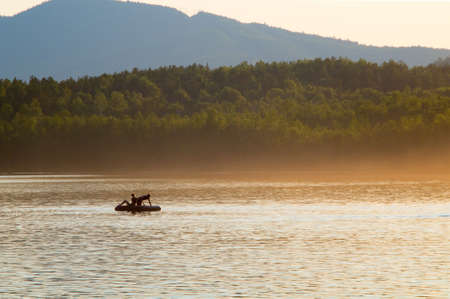far off: two fisherman on cog, far off, beauty morning or evening