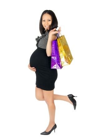 asian young pregnant woman stay with purchase , smile, on  white background, isolated photo