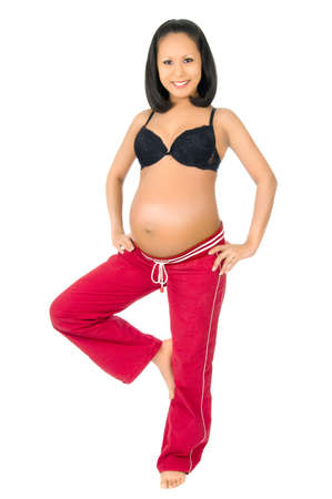 young pregnant woman stay on one leg , on white background, isolated photo