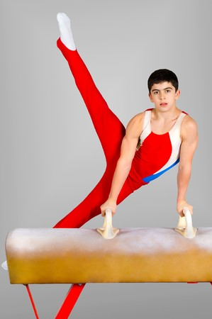 gymnastics sports: The sportsman the guy, carries out difficult exercise, sports gymnastics