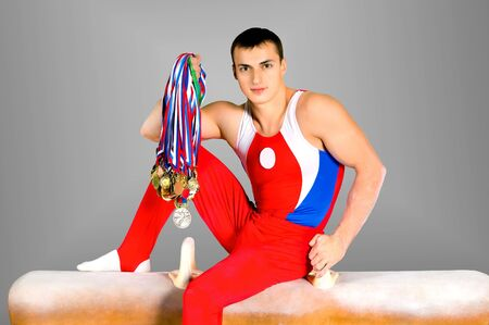 and the horizontal man: image The sportsman the guy, muscles athlete of sports gymnastics Stock Photo