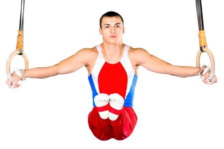 sportsman: El deportista el chico, realiza ejercicio dif�cil, gimnasia, sobre fondo blanco, aislado de deportes  Foto de archivo