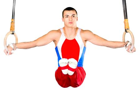sportsman: The sportsman the guy, carries out difficult exercise, sports gymnastics,on white background, isolated