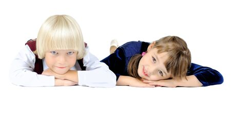 two  little children  lie on stomath and smile, on white background, isolated Stock Photo - 8002017