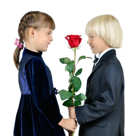 the little boy give rose girl and smile, on white background, isolated photo