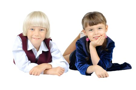 two  little children  lie on stomath and smile, on white background, isolated Stock Photo - 8002014