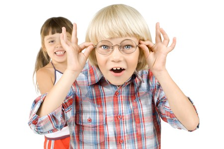 little children boy stare on camera through glasses and smile, on white background, isolated Stock Photo