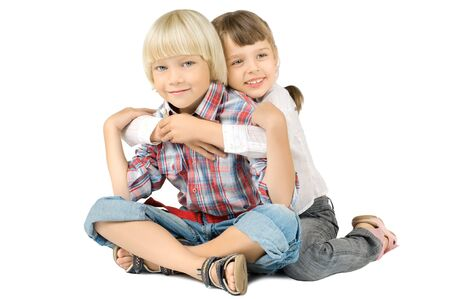 sissy: two  little children  embrace and smile, on white background, isolated Stock Photo