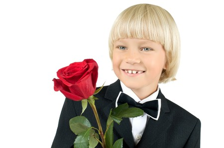 little children boy see on camera and smile with rose, on white background, isolated photo