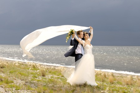 puff: the beauty happy married  couple  stand on coast, puff wind, imminent  storm-cloud