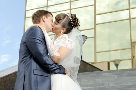cutie happy married  couple  embrace  on architecture background and  hot kiss Stock Photo - 8002286