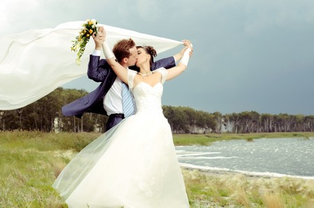 cutie happy married  couple  on nature, puff wind, hot kiss Stock Photo - 8002022