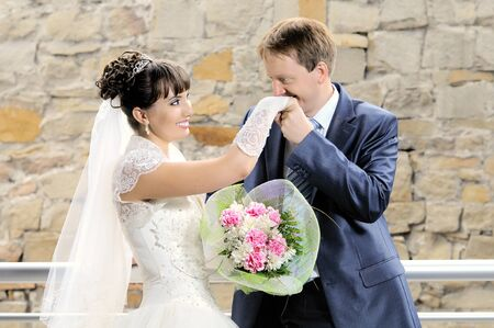 the cutie happy married couple bride on architecture background, smile Stock Photo - 8002314