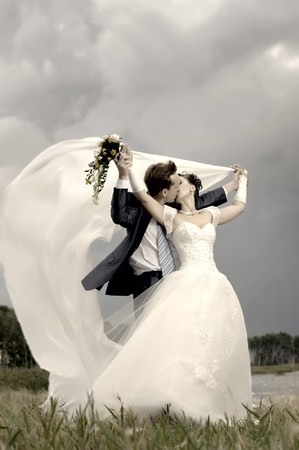 fervent: cutie happy married  couple  on nature, puff wind, hot kiss Stock Photo