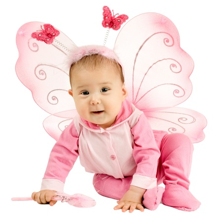 beautiful  little kid with wings, sit and  smile on white background, isolated photo
