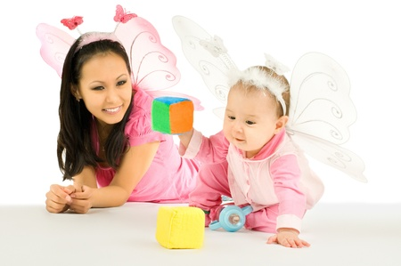 little child and  mum,  play with bricks, on white background, isolated Stock Photo - 8458843
