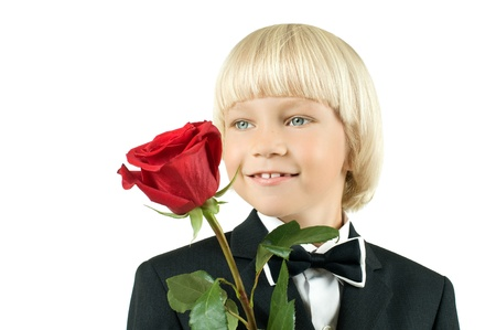 little children boy  smile with rose, on white background, isolated Stock Photo - 8458822