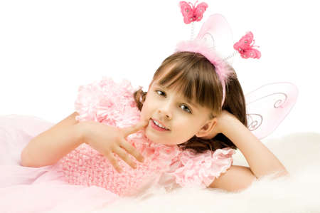 beautiful  little girl with wings, lie and  smile on white background, isolated Stock Photo - 8458848