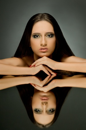 the very  pretty woman with  reflect in mirror, sensual sexuality gaze... photo