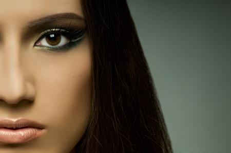 the very pretty woman, very close fase , sensual strict gaze...