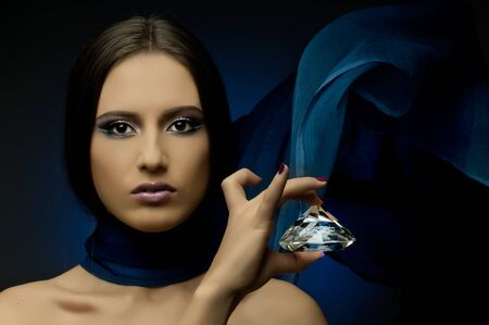 the very  pretty woman with dark blue neckerchief,  with huge brilliant, sensual sexuality gaze... photo