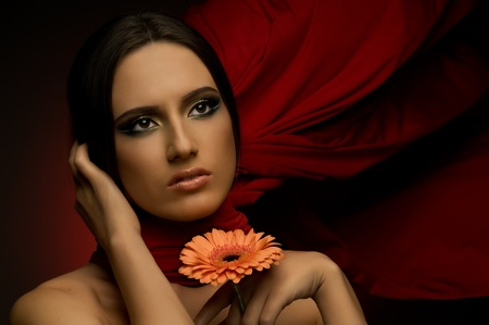 the very  pretty woman with red neckerchief, with chrysanthemum, sensual sexuality gaze... photo