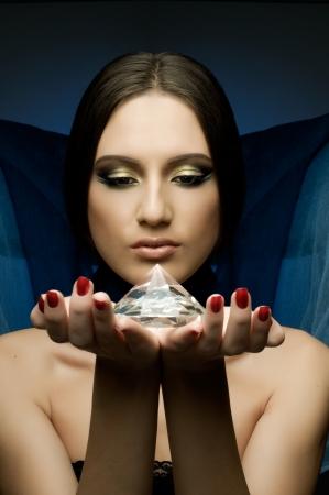 the very  pretty woman with dark blue neckerchief,  with huge brilliant, sensual sexuality gaze... Stock Photo - 8458808