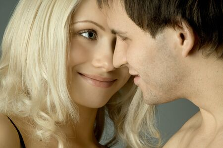 the happy  pretty couple, smile,  close face, look eyes to eyes photo