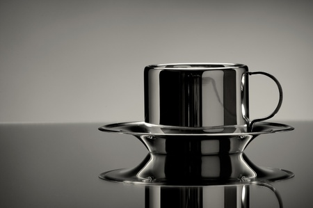 the beautiful still cup on mirror close ,  on grey  background Stock Photo - 8874175