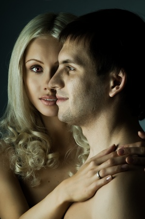 vehement: guy with pretty woman, happy couple, very close face, girl look on camera, glamour light Stock Photo