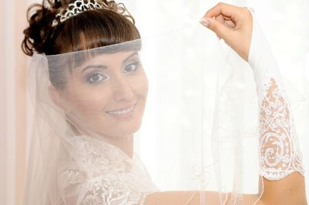 fiancee: The young beautiful  happy fiancee, dress up ,  smile and see on camera