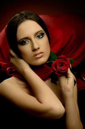 the very  pretty young woman with red neckerchief, with rose, sensual sexuality gaze... Stock Photo - 9003245