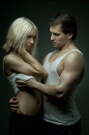muscular handsome sexy guy with pretty woman, on dark background, glamour  light Stock Photo - 9208869