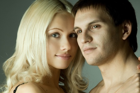 guy with pretty woman, happy couple, very close face, girl look on camera, glamour light photo