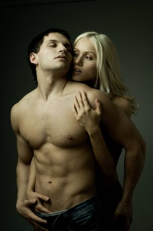 muscular handsome sexy guy with pretty woman, on dark background, glamour light Stock Photo - 9209527