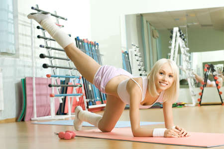 cutie: happy cutie athletic girl ,  execute exercise  and smile, in  sport-hall