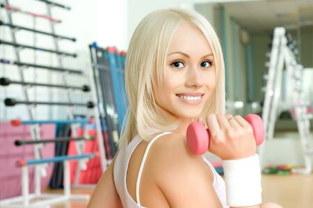 cutie: happy cutie athletic girl ,  execute exercise  with pink dumbbells and smile,  close up face
