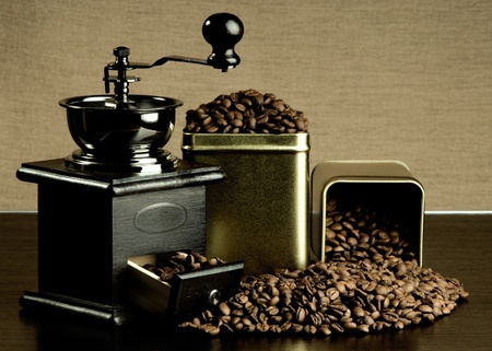 a jar stand: the coffee-grinder stand with great plenty coffee in  jar, close-up