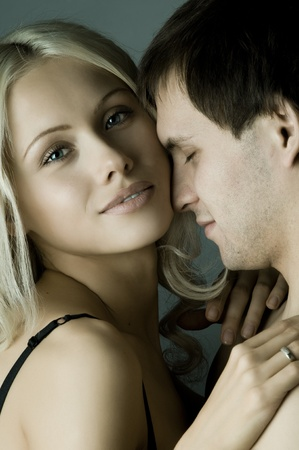 impassioned: guy with pretty woman, happy couple, very close face, girl look on camera Stock Photo