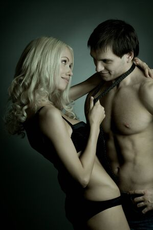 muscular handsome sexy guy with pretty woman, on dark background, glamour  light Stock Photo - 9649252