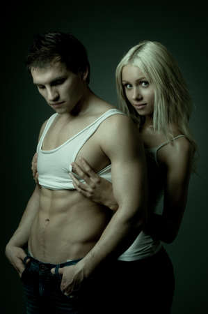 muscular handsome sexy guy with pretty woman, on dark background, glamour  light Stock Photo - 9649245