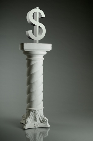 photo beauty white monument-column  with symbol dollar on gray background photo