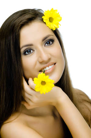 sexuality: the very  pretty woman on white background, with yellow camomile, sensual sexuality gaze, isolated