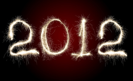 Date New Year 2012 of photo sparkle Bengal light on dark red background, collage of figure Stock Photo - 10084746