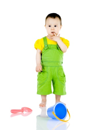deplorable: alone unhappy little kid , stand with toy on white background, isolated