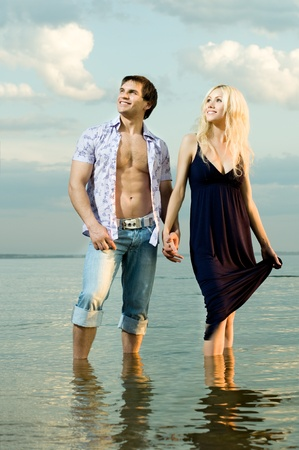 muscularity: sexy beauty guy and girl outdoor in river, happy smile