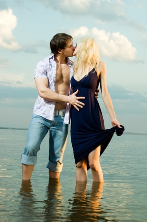 young fellow: happy sexy beauty guy and girl outdoor in river, kiss